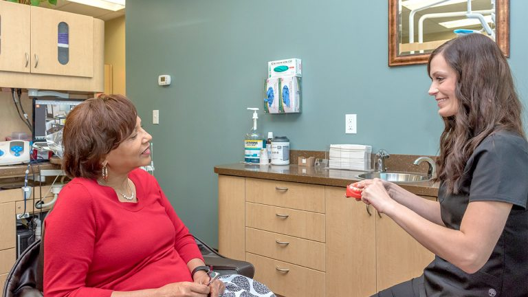 Hygienist discussing hygiene with patient